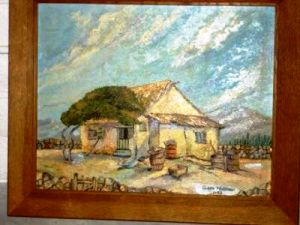 This cottage scene in oil by an unknown artist sold for $30. (Source: Proxibid, Worthopedia Price Guide)