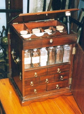 Georgian apothecary chest, made by a British cabinetmaker of mahogany, is filled with the tools of the doctor's trade. It sold in 2003 for $3,500.