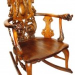 This ornately carved rocker is a Stickley, but not Gustav Stickley's work; it was made by brother Charles Stickley and the Stickley-Brandt Furniture Company. When they are identified for what they are, these ornate Stickley-Brandt rockers often sell in the $600- $800 range.