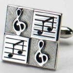 Silvertone music theme cufflink set with a G clef and musical notes motif.