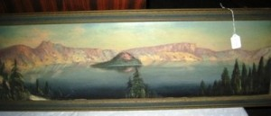 There are bargains to be found everywhere. This oil painting of a mountain lake sold for $13 (Source: Proxibid, Worthopedia Price Guide)
