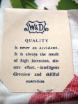 The back of the Wilendur label declares the company's commitment to quality. This dedication to quality is one reason why so many of their tablecloths are still around today in fairly good condition.