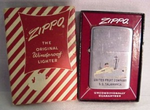 Zippo United Fruit Co SS Talamanca Ship Lighter. This lighter is in very good condition, with only minimal scratching. This item comes with it's original box, which is in good condition also. The box does have some wear, including very slight soiling and edge wear, and a tear in the paper as you can see from our photos. This item is marked Patent # 2032695, indicating that it dates pre-1950s.