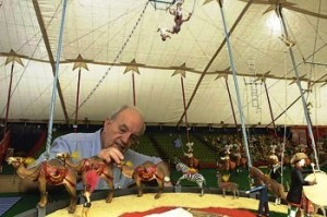 Philanthropist and model builder Howard Tibbals puts the finishing touches on the Howard Bros. Circus, the largest miniature circus in the world. The circus is now on permanent display in the Ringling Circus Museum's Tibbals Learning Center.