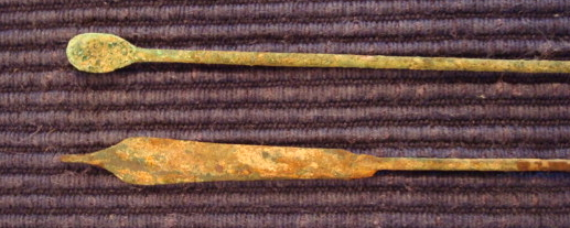 The blades of these two scalpels demonstrate the leaf shape of ancient (circa 300 B.C.) scalpels. Their wood or bone handles have long since disappeared.
