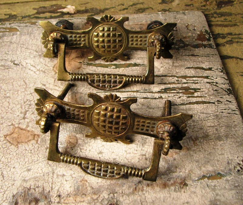 You should remove your brass hardware, such as these drawer pulls, before cleaning.
