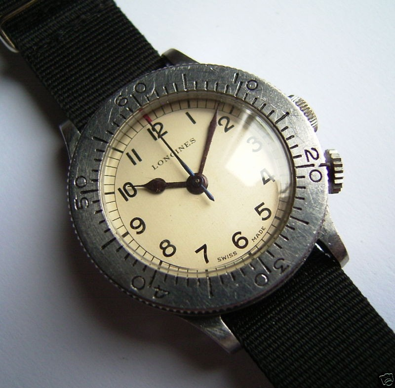 This Longines World War Two Pilot's Wristwatch, with a Wheem's aircraft navigational calculation bezel, is an early and quite rare Longines Aircraft Navigation watch.