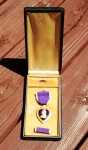 Purple Heart medal with ribbon bar and lapel button.