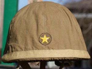 This WWII Imperial Japanese Army helmet with a 2nd pattern cover is in very good condition, and 2nd pattern covers are actually harder to find than the 1st pattern. If you are contemplating the purchase of an item you intend on upgrading later, don't waste your money, as the flaws you see in the item are the same flaws a future buyer will see when you try to sell it.