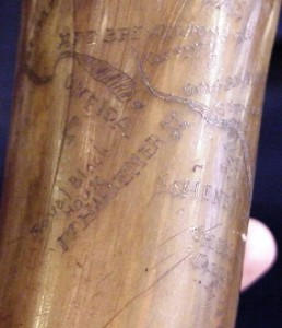 This is a close up of a map horn carved into a Civil War-era powder horn showing a river course with towns and forts.