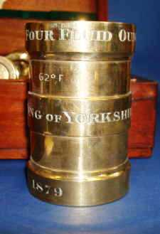 Close up of the marks on the apothecaries measures. The dates range from 1879 to 1949.