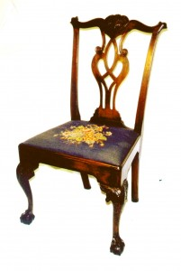 A Philadelphia chair circa 1776 shows the rococo changes Chippendale made to the basic Queen Anne chair.