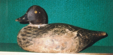 Elmer Crowell female Goldeneye decoy I sold for $900 15 years ago at the Holiday Antique Show in Williamsburg, Va. It is one of his working decoys and in rough shape, with paint rubbed off at the breast. Even so, it's a lovely decoy.
