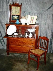 Items to be sold include a Seth Thomas mantle clock with painted reserve and a butler's chest with desk drawer.