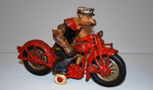 """Hard-to-find Hubley """"Popeye"""" patrol Indian toy motorcycle ($2,310)."""