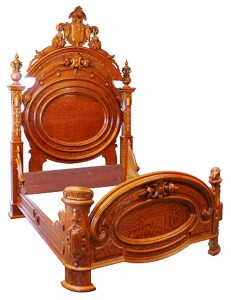 A Renaissance Revival bed, circa 1875, reflects the architectural element of the style.