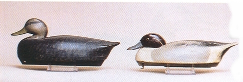 A Wildfowler blackduck decoy is on the left and a low head pintail drake is on the right. These decoys as a lot only went for $500 at a 2003 Guyette and Schmidt auction. Photo courtesy of Guyette and Schmidt.
