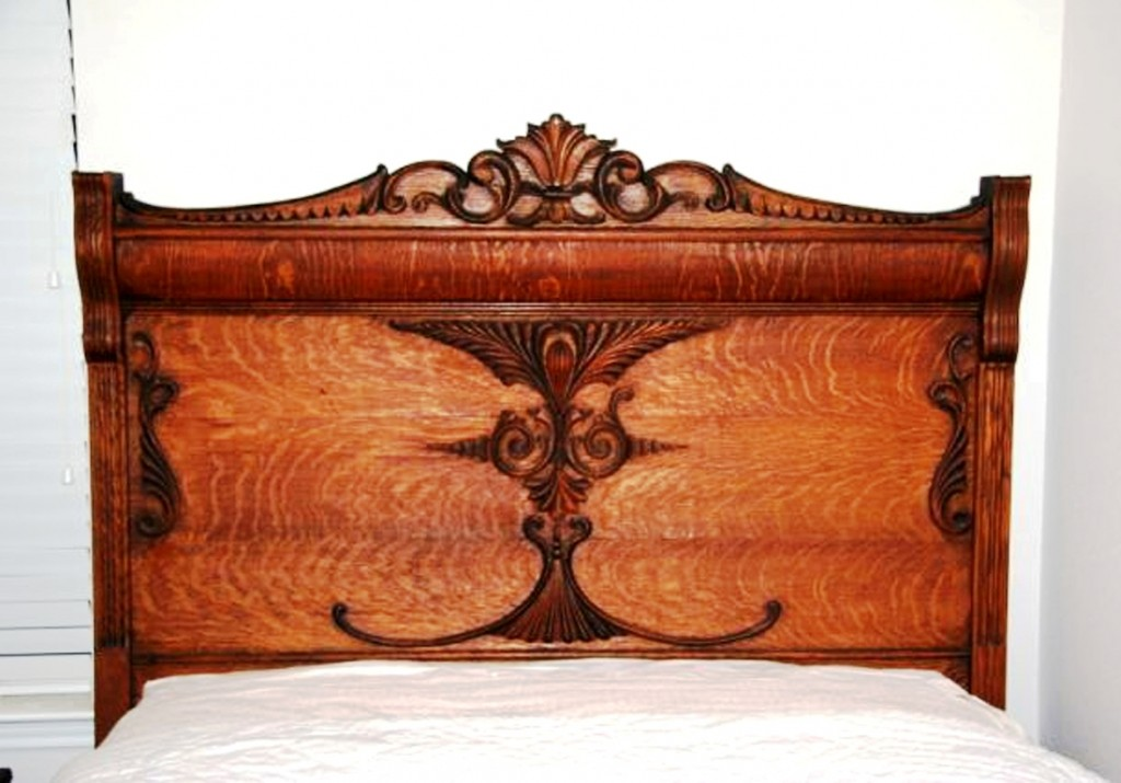 "The tag says ""Hand-carved oak headboard..."" The tiny nails in the ""carvings"" attest to the fact that they are applied molding."