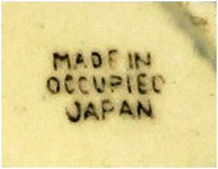 MIOJ black ink stamp. The color is not significant and has no bearing on the value of the item. The unevenness of the letters is typical and appears in nearly all OJ marks.