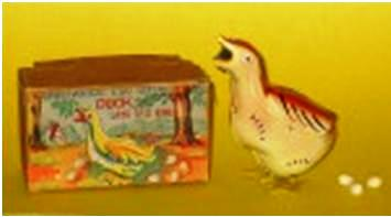 A most ingenious wind-up toy duck that lays eggs. The celluloid eggs are loaded into the mouth and after winding it up, the duck waddles around and lays the eggs. The toy is more valuable because of the original box, but in this case it's essential because the MIOJ mark is only on the box. The Duck carries the name Japan under its wing.