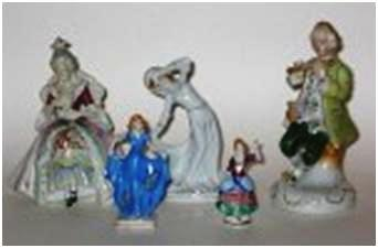 A group of OJ Glazed Porcelain figurines, from three to six inches tall, in period dress from the 17th century right up to modern day at the time (i.e. 1950s).