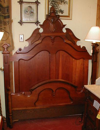 "The tag says ""200-year-old, hand-carved Renaissance Revival bed..."" Renaissance Revival was mid-19th century. It has another 50 years to go before it could be 200 years old, and most RR furniture was factory made, not hand carved."