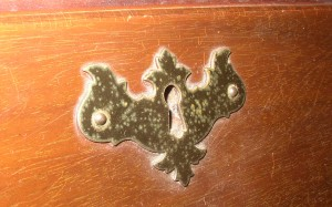 This Chippendale batwing escutcheon is from the 1940s.