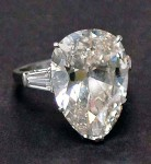This pear shaped 12.4-carat diamond in a platinum ring with baguettes sold for $75,000.