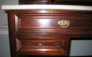 This desk drawer combines a drawer pull with an escutcheon.