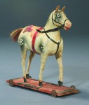 Antique and papier-mache and wood horse.