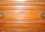 This turn of the 20th century bookcase drawer has a very unusual Star of David escutcheon.