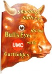 This UMC Shooting Gallery Bull's Eye Cartridges lithographed tin sign, shaped like a bull's head, sold for $4,068.