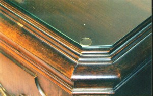 "A piece of glass almost always has a microscopically thin layer of moisture on the surface. This moisture will ""grow"" to the finish on furniture sticking the glass to the piece resulting in finish damage when the glass is removed. Allowing air to circulate under the glass using spacers like this clear disc eliminates that problem."