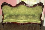 A sofa by J.H. Belter in the Rosalie with Grapes pattern.