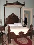 A half-tester bed, signed C. Lee.