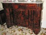 A mahogany Empire sideboard