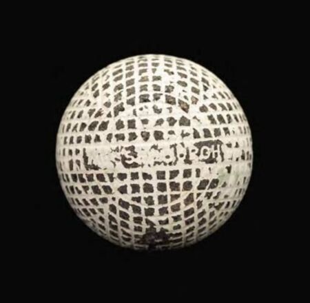 """You can get serious about your collection, too. This A J. & D. Clark """"Musselburgh"""" mesh-pattern gutty ball, still retaining some of the original paint, sold for $7170 at auction at Freeman's."""
