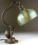 This Tiffany Studios counterbalance desk lamp with bronze base and green damascene shade brought $8,050.