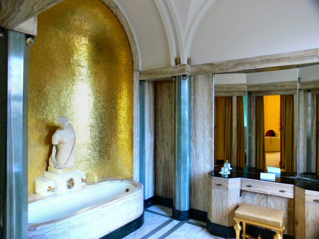 Virginia Courtauld's onyx bathroom with gold mosaic tiles and gold-plated taps.