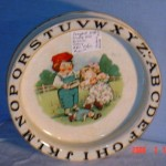 An Alphabet dish made by Buffalo Pottery featuring the Campbell Soup kids.