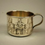 A sterling silver baby's cup made by American silversmiths at Gorham with ABC decoration.