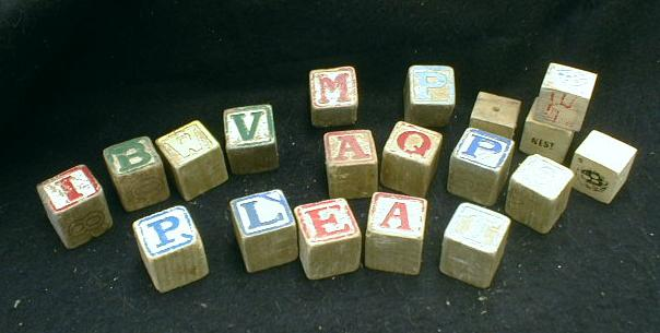 These old wooden toy blocks, made in the early 20th century,  feature letters of the alphabet, as well as drawings of animals, etc. Some of them are faded and the edges are worn.