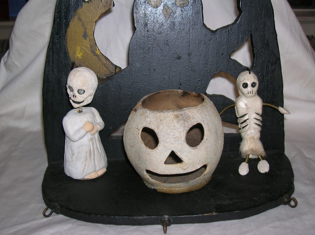 Another example of an early Halloween decoration. The ghost on the left has a head that bobs on a spring and the candy drawer is inset under his feet.