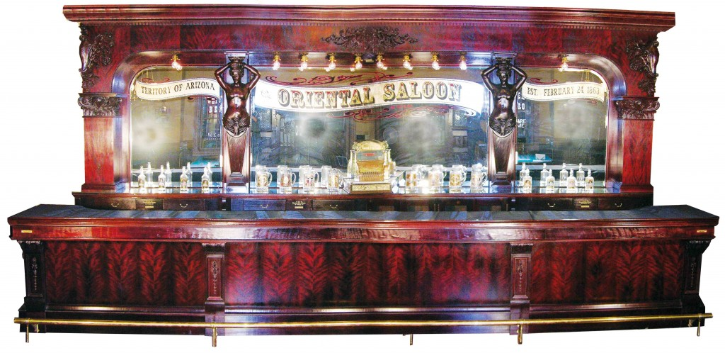 Front and back bar with original matching liquor cabinet by Brunswick, Balke & Collender Co. soared to a record selling price of  $302,500 at the living estate sale of Ron Wallace, a dedicated collector and the former president of UPS.