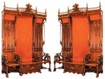 Pair of flamboyant and monumental Gothic throne chairs in black walnut, from the Yellowstone Club in Montana, will be auctioned on Nov. 6-8.