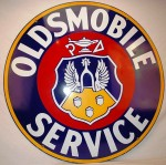 Oldsmobile Service 42-inch double-sided porcelain sign with crest logo and great gloss was hammered at $5,170.