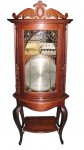 This Regina bowfront changer antique music box in a rare oak case sold for $19,550.