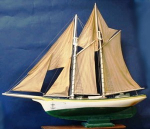 This hand-made schooner rig pond yacht is 43 long and stands 38 inches tall. It is a solid hull construction with lead inlet into the keel. Value in a retail setting is about $850.