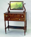 This well-crafted early 19th century American mahogany dresser with lyre carved supported mirror brought $1,840.