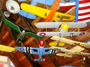 The collection of model planes is so extensive some of them—like these—are suspended from a ceiling.